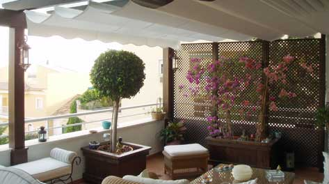 Ideas para decorar una terraza atico 2015 for Decoracion de terrazas cerradas